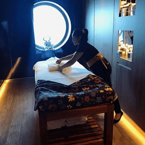 A room with a single massage table